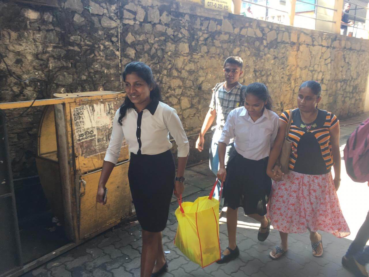 Local school students helped distribute dry ration packs for Christmas to families with blind adults - Sri Lanka
