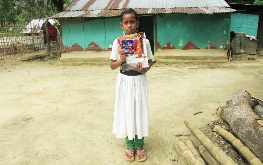 Agnes, 8, is one of the tea kids you help go to school in Bangladesh
