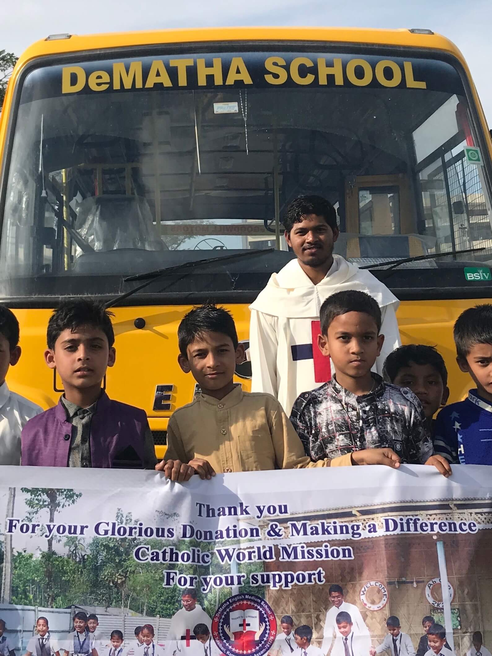 India - Trinitarian Fathers & school children - Thank you for the bus!