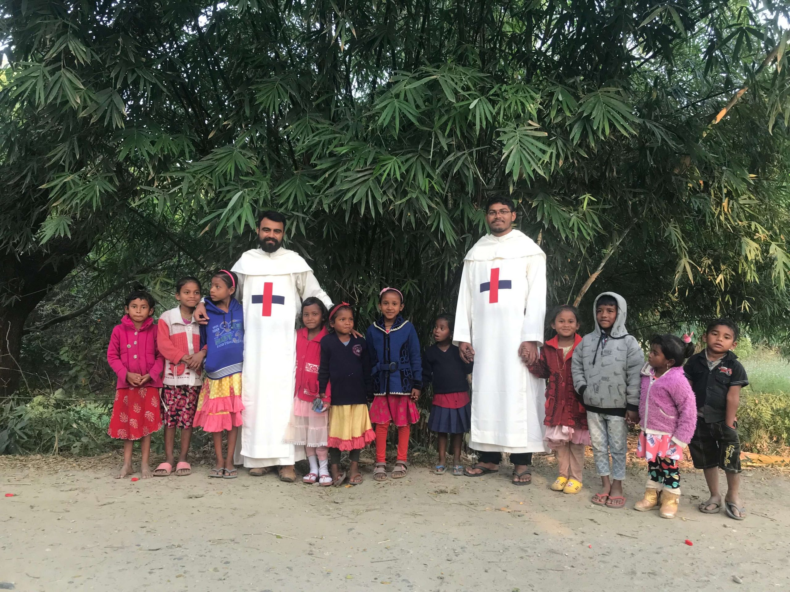 India - Trinitarian Fathers with school children