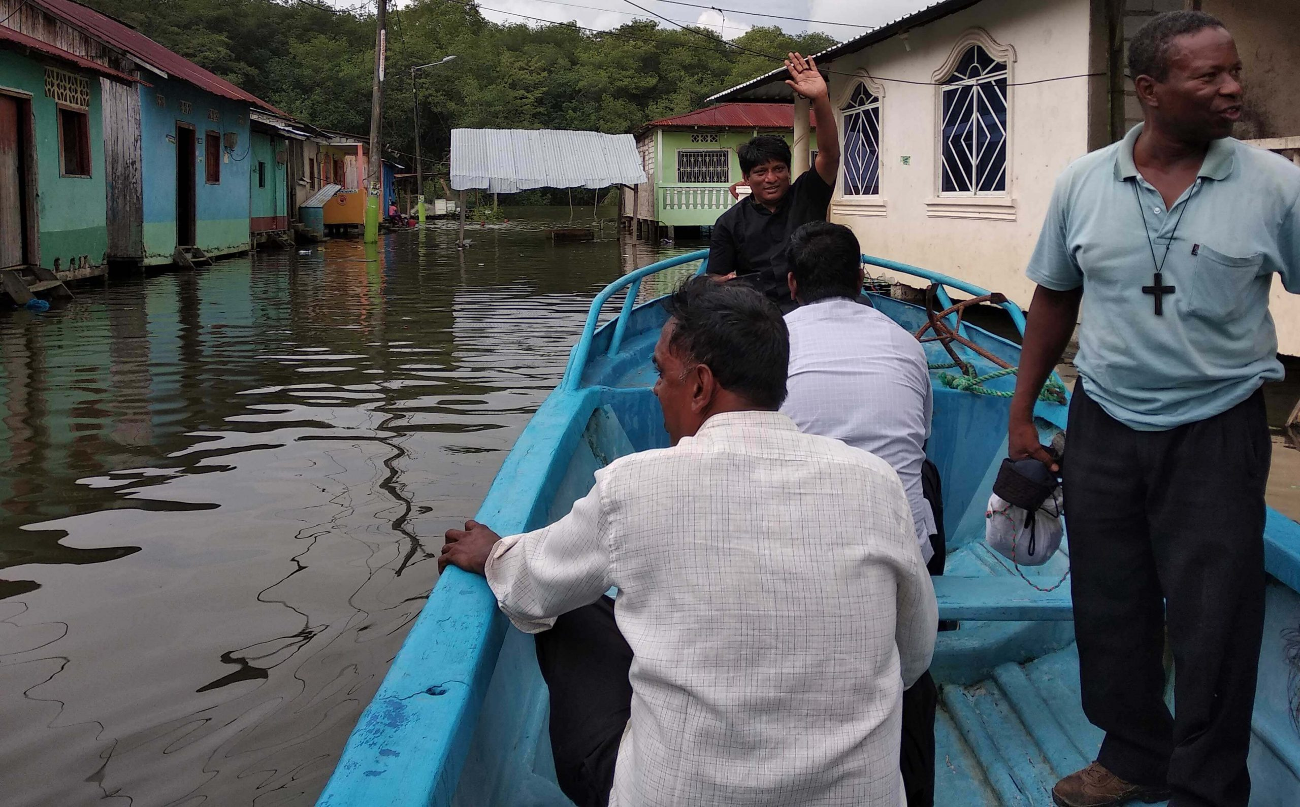 Missionaries visiting a remote village. Many of these poor fishing villages are only reachable by boat!