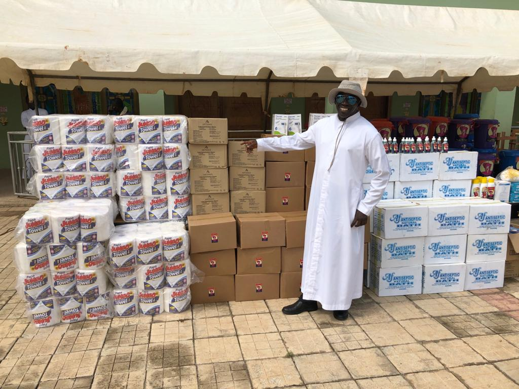 2. Fr. Anthony Eshun stands with supplies for local hospitals, which were gathered by the local Catholic community to help all in need