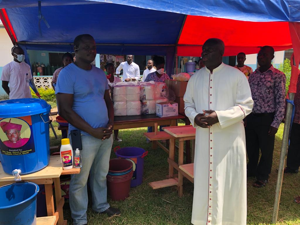 6. Msgr. Simon visits with people who will distribute supplies to local hospitals