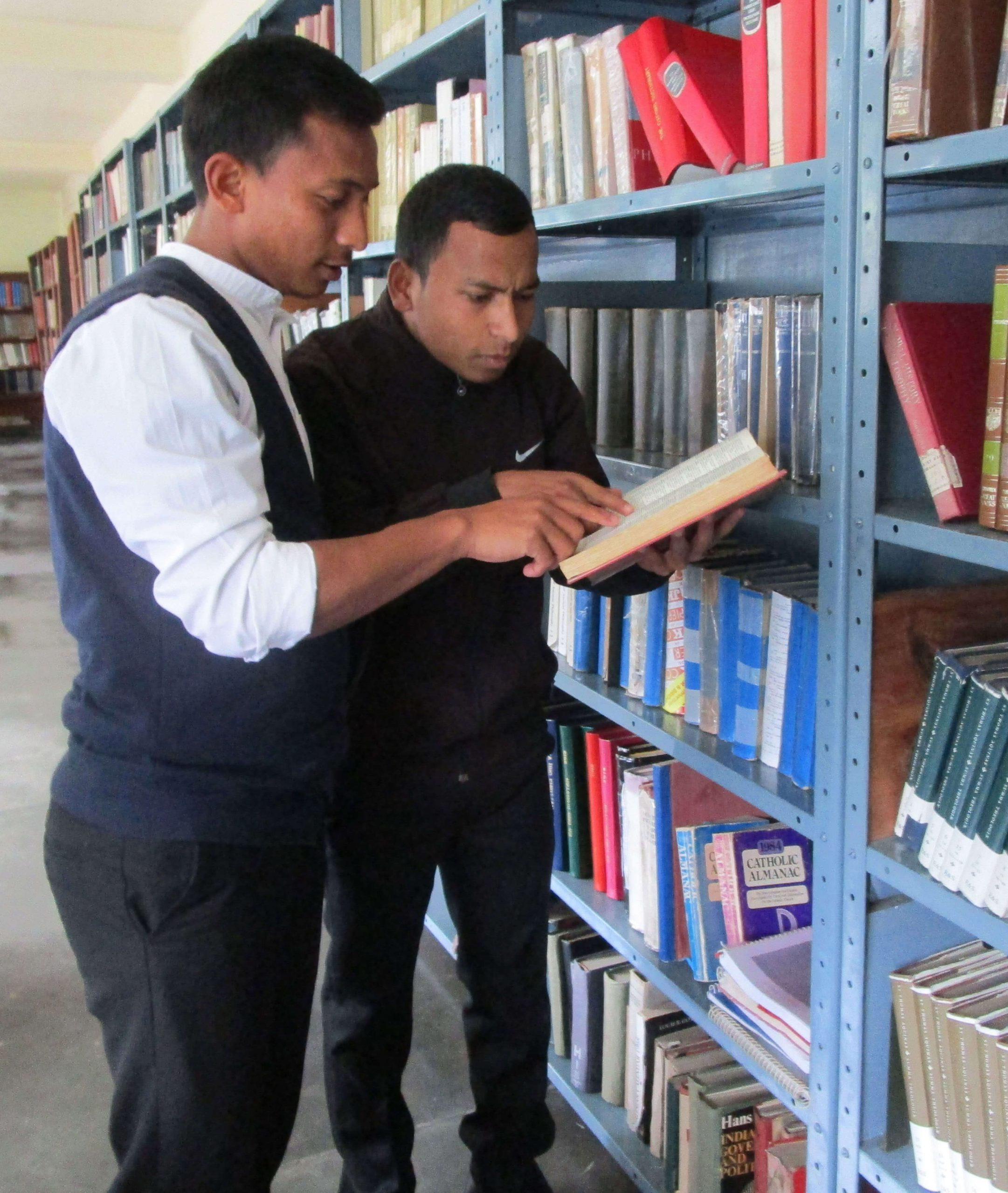 Seminarians helping each other study