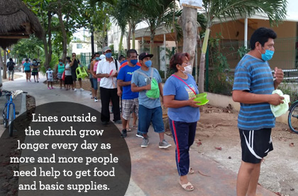 Lines outside the church grow longer every day as more and more people need help to get food and basic supplies.