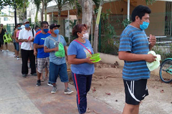 Mexico - Solidarity Supper feeds the hungry in Playa del Carmen neighborhood.