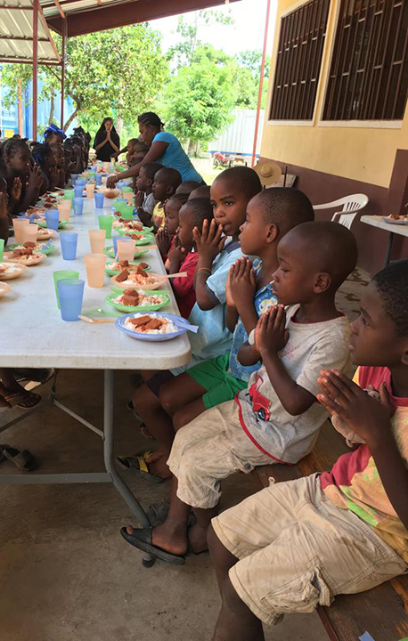 Children praying before a meal in Haiti