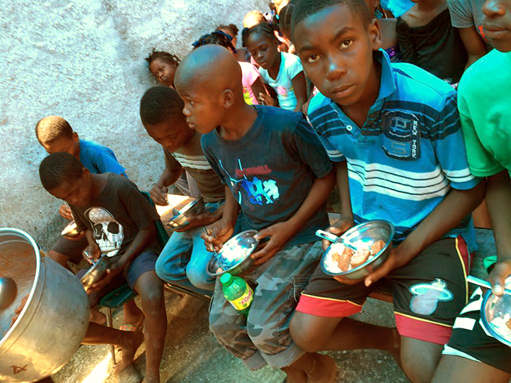 Kids eating their meal in Haiti