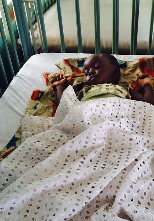Sick child at a hospital in Ghana