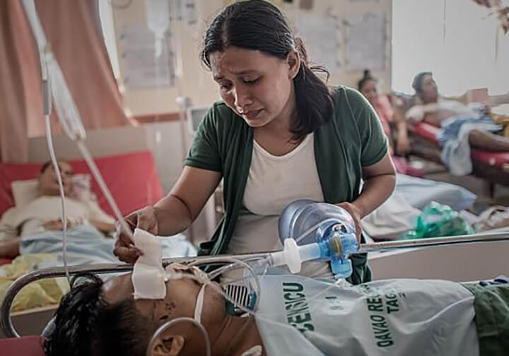 Wife taking care of her husband at a hospital in Philippines