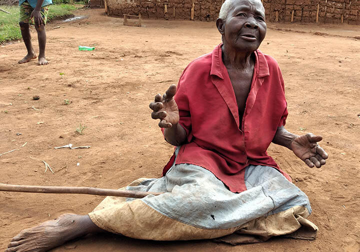 95-year-old Mbwali Teopista takes care of her grandkids in Uganda