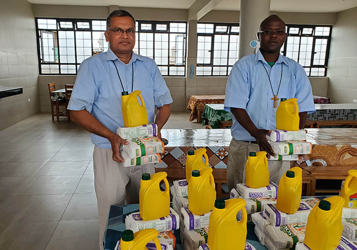 MOP brothers receiving provisions for Kenya orphanage