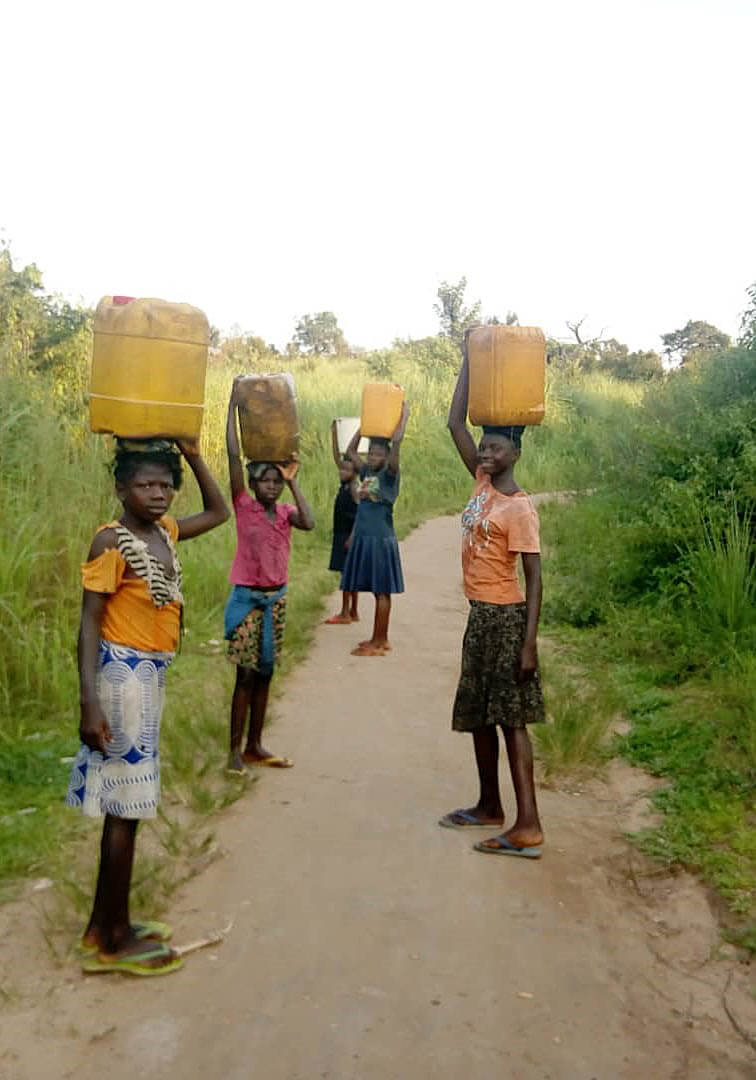 Girls back from river 4km away to get clean water