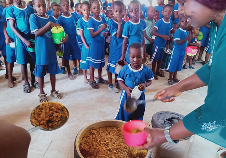 Teachers prepared and served, and received meals themselves