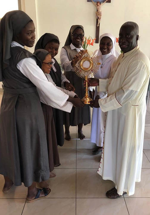 Delivering Monstrances in Ghana, Sister of the Oblate and Msgr. Simon
