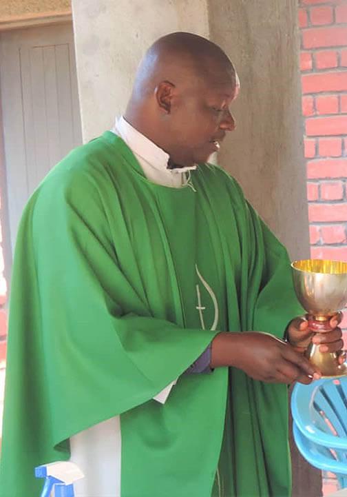 Msgr. Paul Musana celebrating mass
